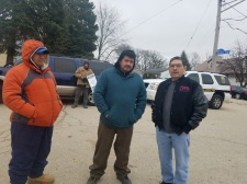 Railway Bargaining Committee member Roberto Luna (center) speaks with ReaderLink Union Steward, Carlos Lozano (far right). Lozano visited the strike line to show his support after completing his own contract negotiations last fall (01.23.17)