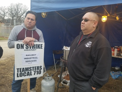 Brother Chuck Castañeda (right), Local 727 Union Steward from Coca-Cola, donated four cases of water to the Railway Industrial strike line (01.23.17)