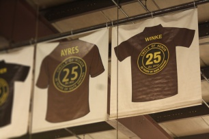 Tom Winke's 25-Year Circle of Honor hangs from the rafters at the Joliet barn.
